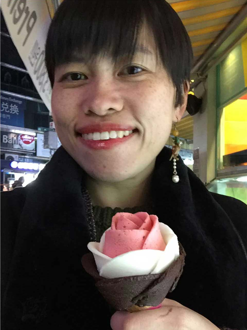 (I couldn't seem to decide what made me happier when I took the shot: (1) the weird earring, (2) my yogurt, strawberry, and dark chocolate ice-cream rose cone, or (3) taking my first successful selfie at the tender age of 28.)