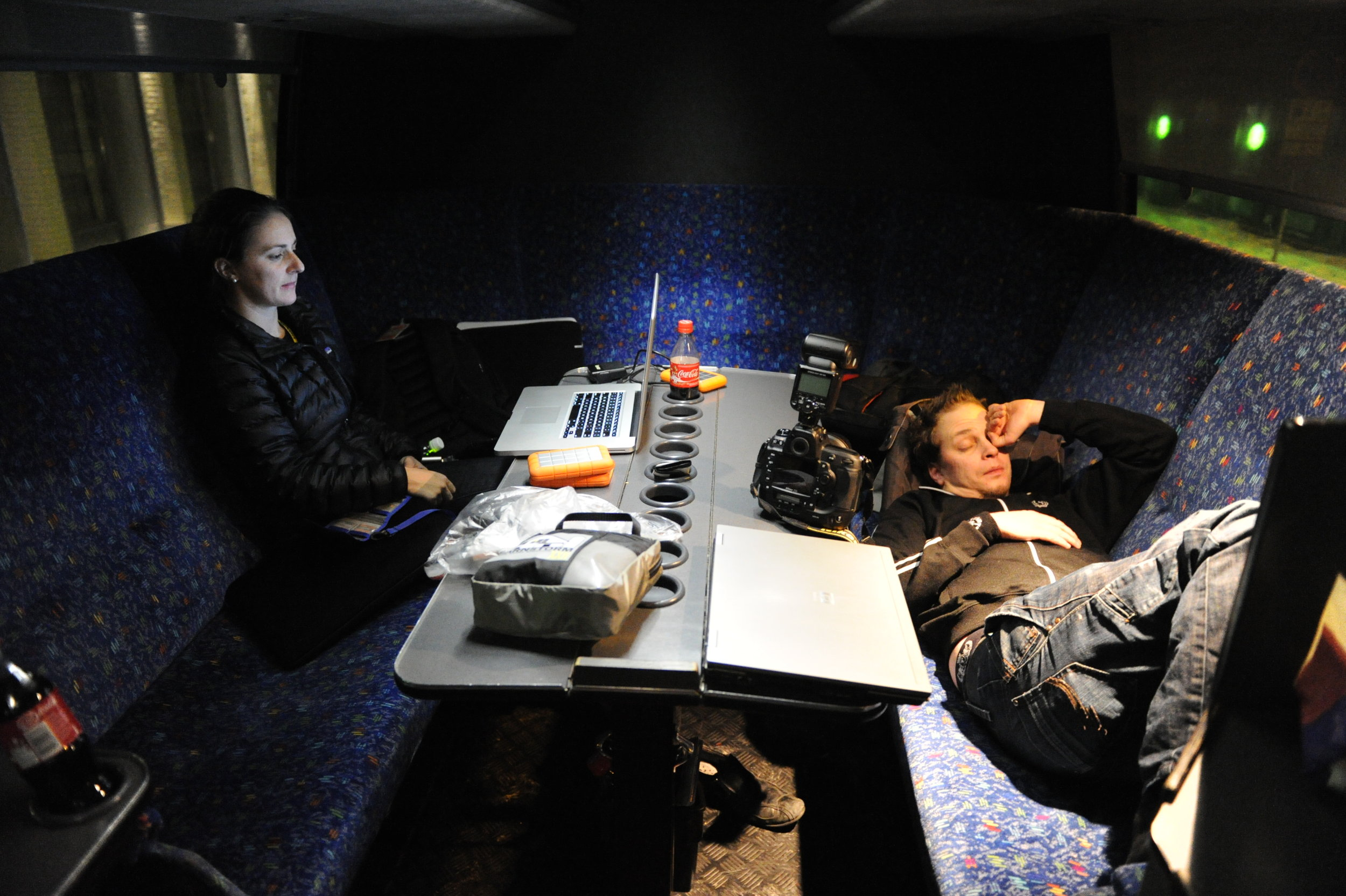 Editing on the tour bus back to Helsinki with Mattias sleeping on the bench across from me.
