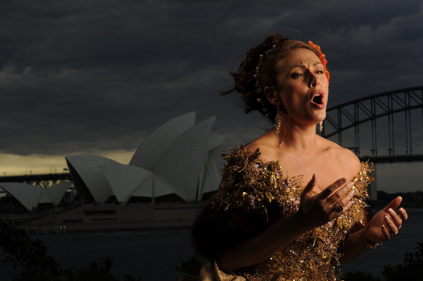 Sydney opera singer in front of the Sydney Opera House.