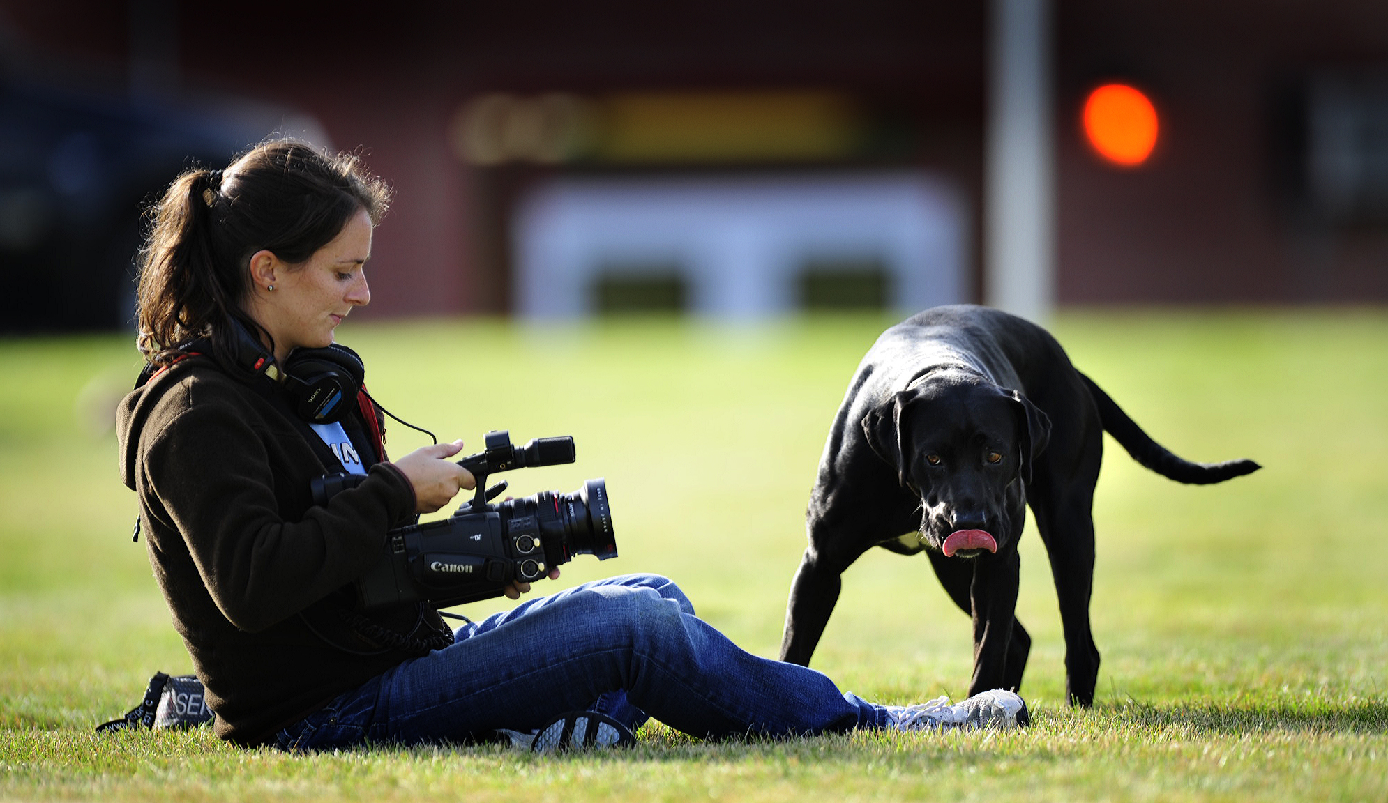 Learning how to shoot video on the fly with the Arthur wolves team dog (in my experience, every small town in Nebraska has a dog at practice).