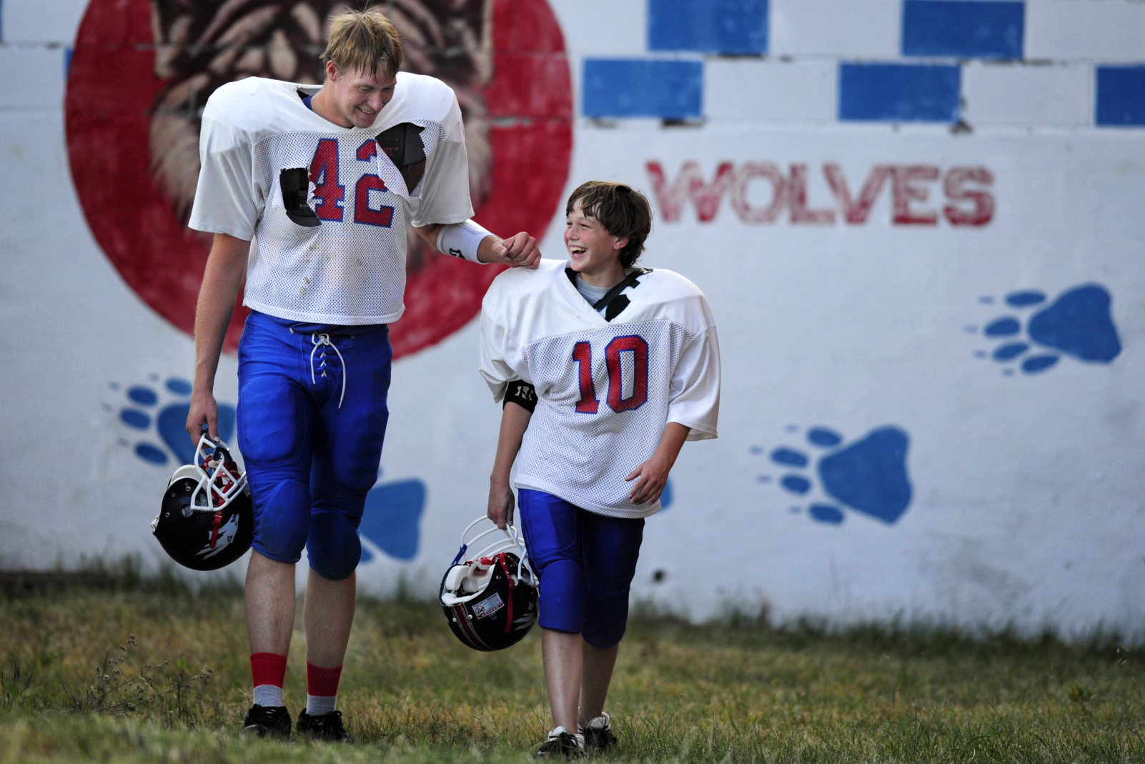 Will Lagey (10) walks onto the practice field with a tall teammate.