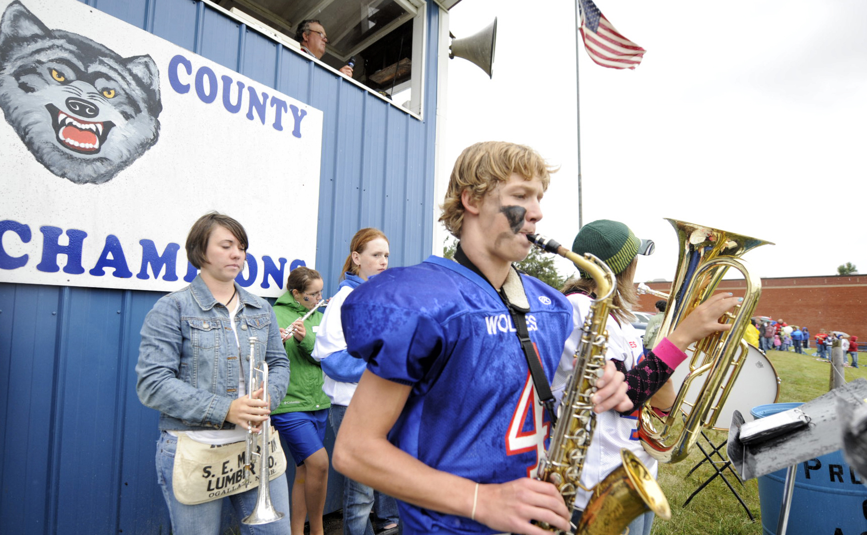 Anthony (4) plays the saxophone in the school band before kickoff at their homecoming game.