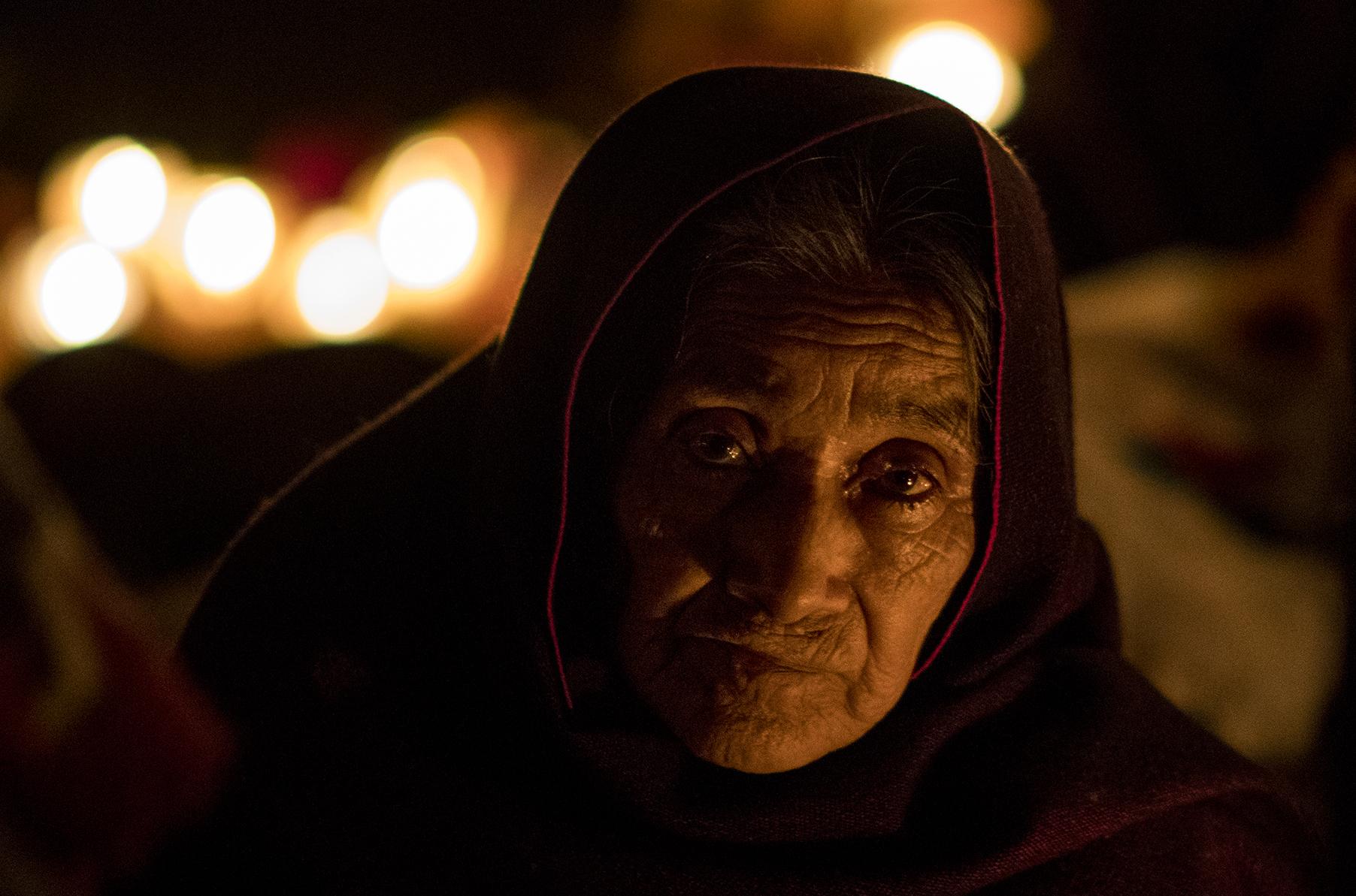 A woman in Tsin Tsun Tsan on el Noche de los Muertos.