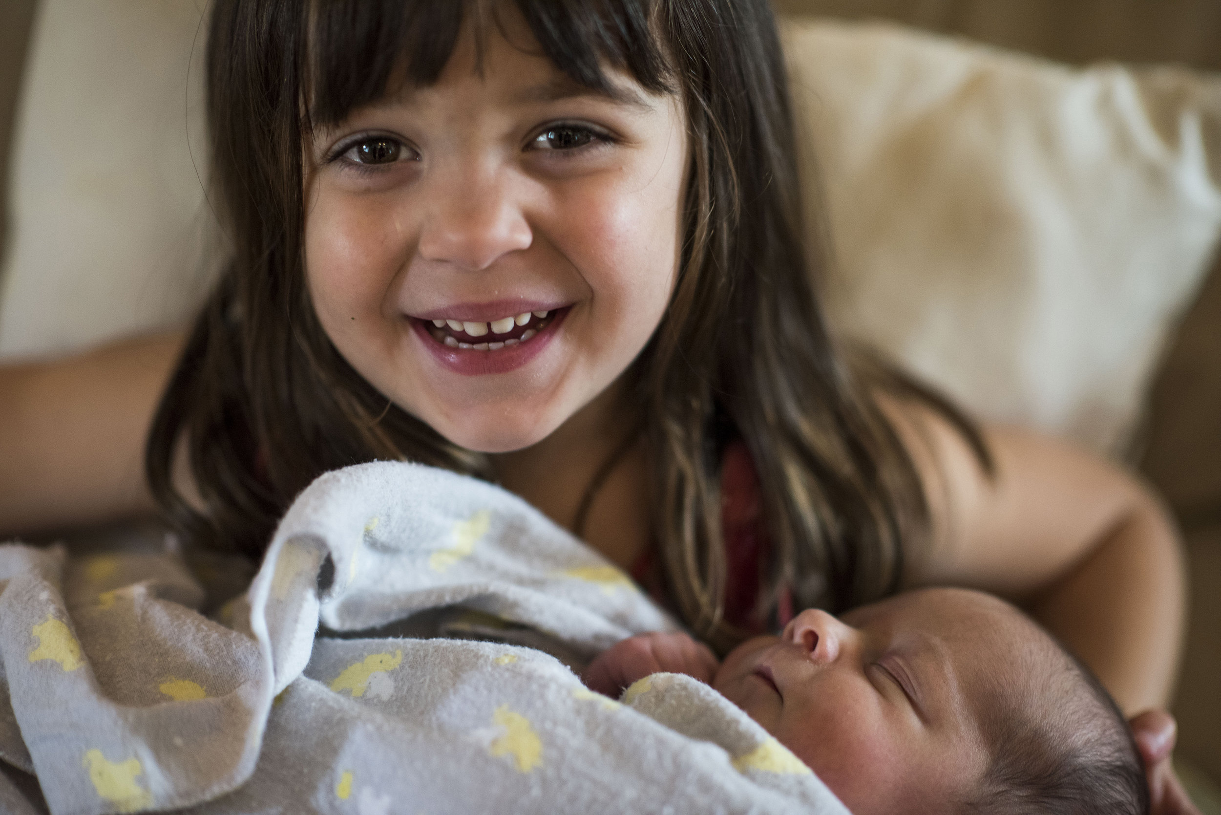 Sofia, now 3.5 years old, holds her baby brother, James.