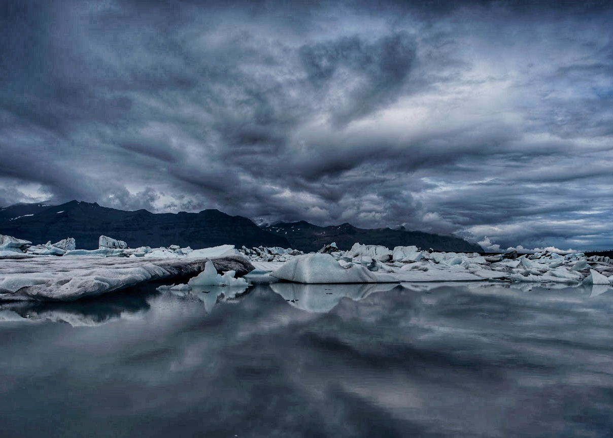 A glacier lagoon on the northeast coast of Iceland where sea and sky seemlessly blend.