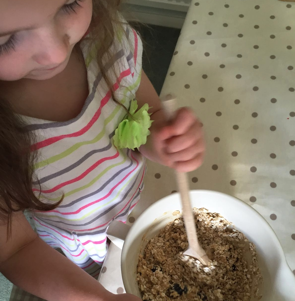 Mixing in the the oats and blueberries