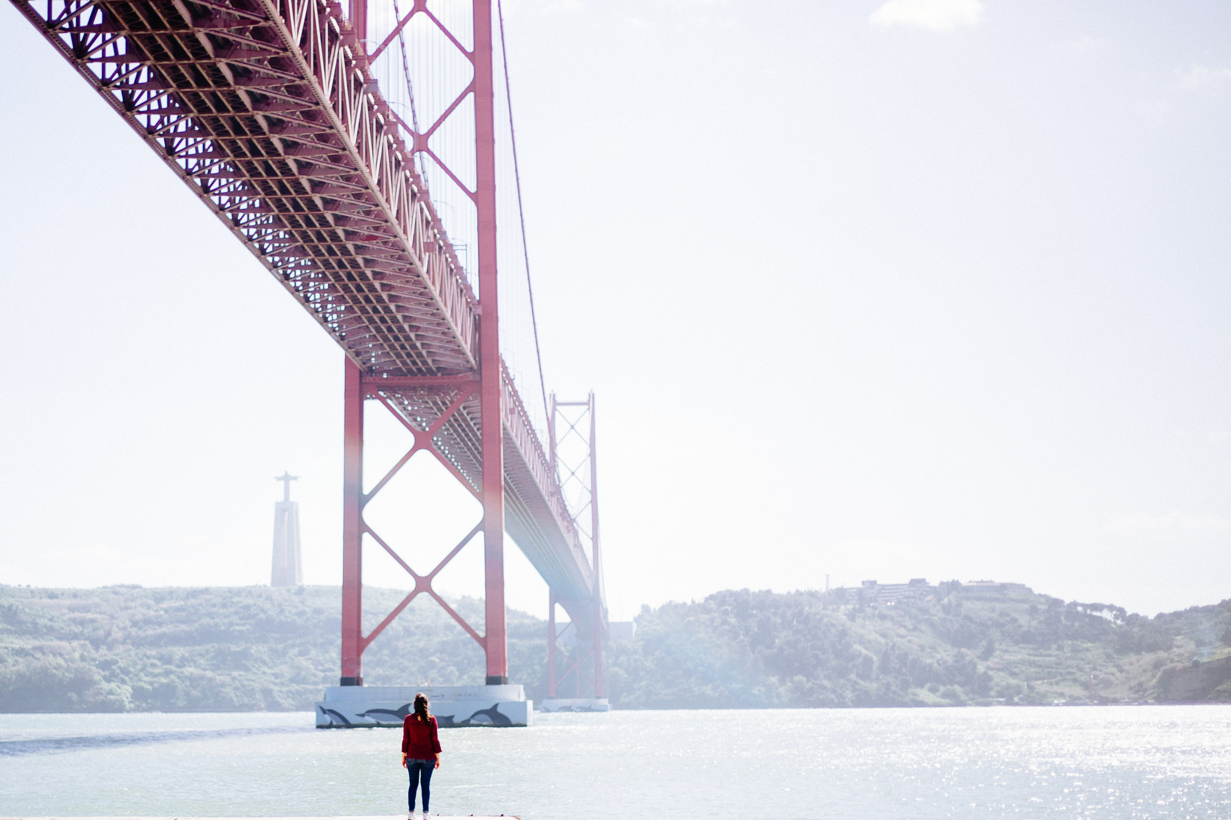 25 de Abril bridge and the Sanctuary of Christ the King looking over the city of Lisbon