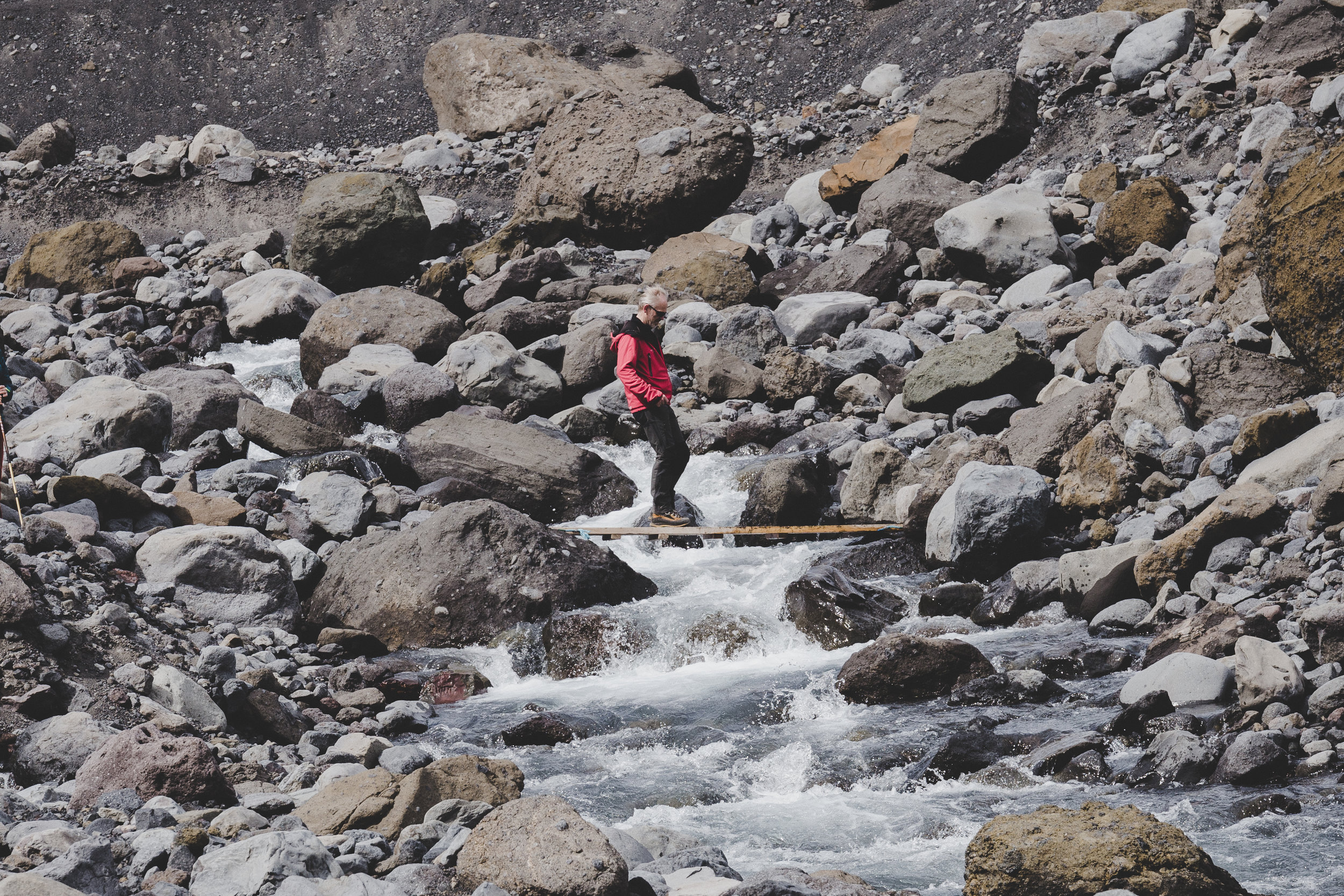 Our guide crossing the river at Gígjökull
