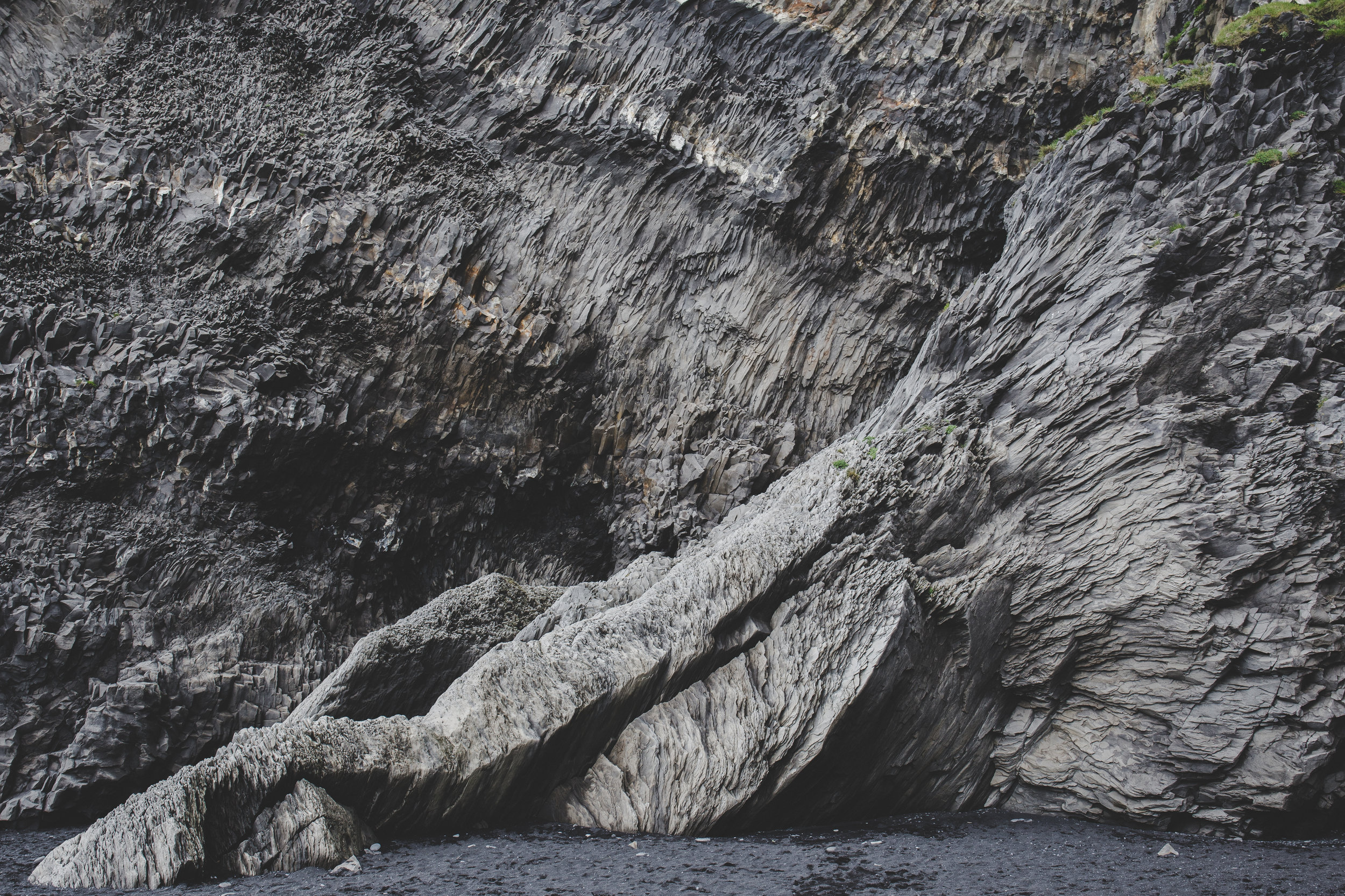 Rock formations on the black sand beach