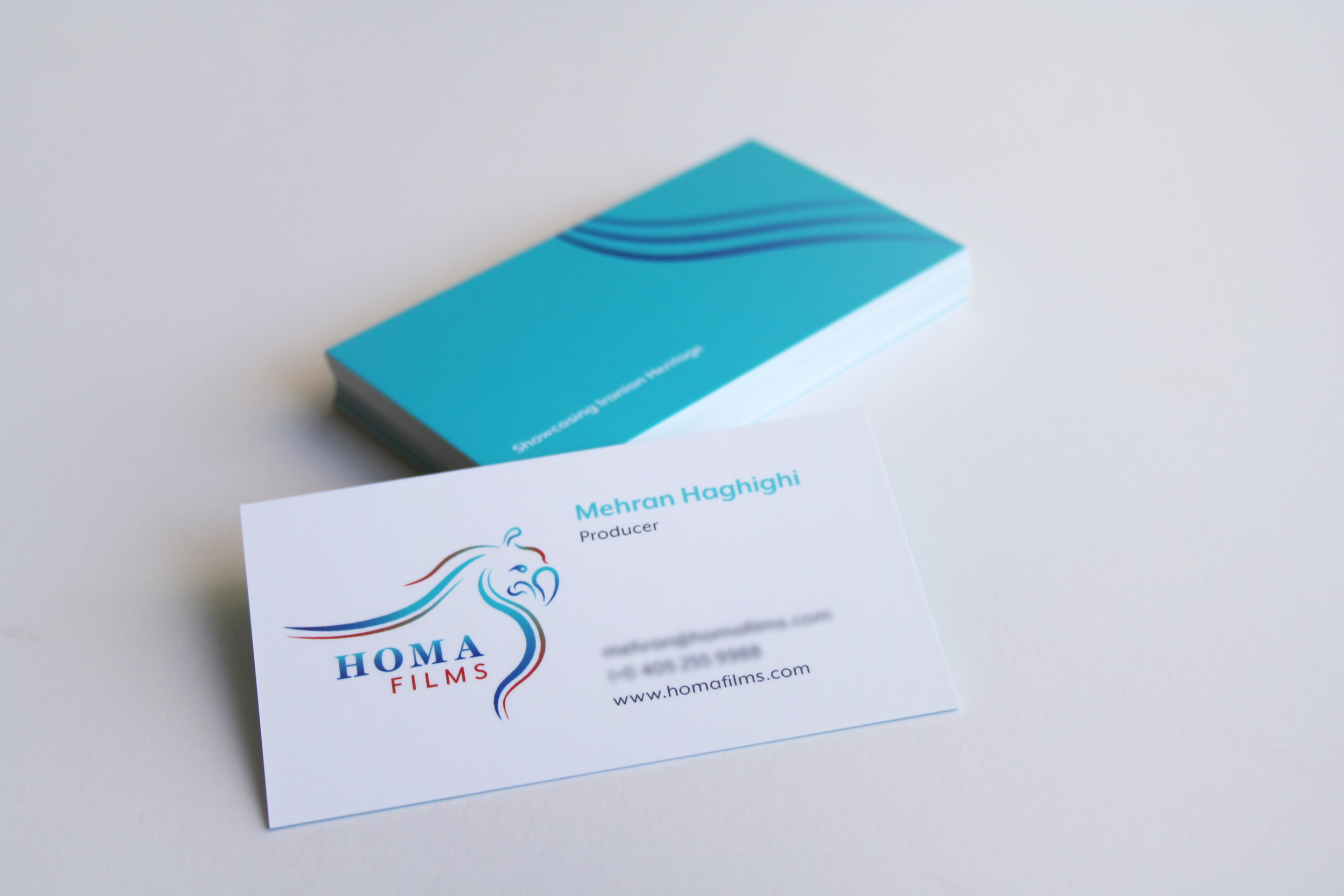 Brand Identity and business card for Homa Films (process files available upon request)