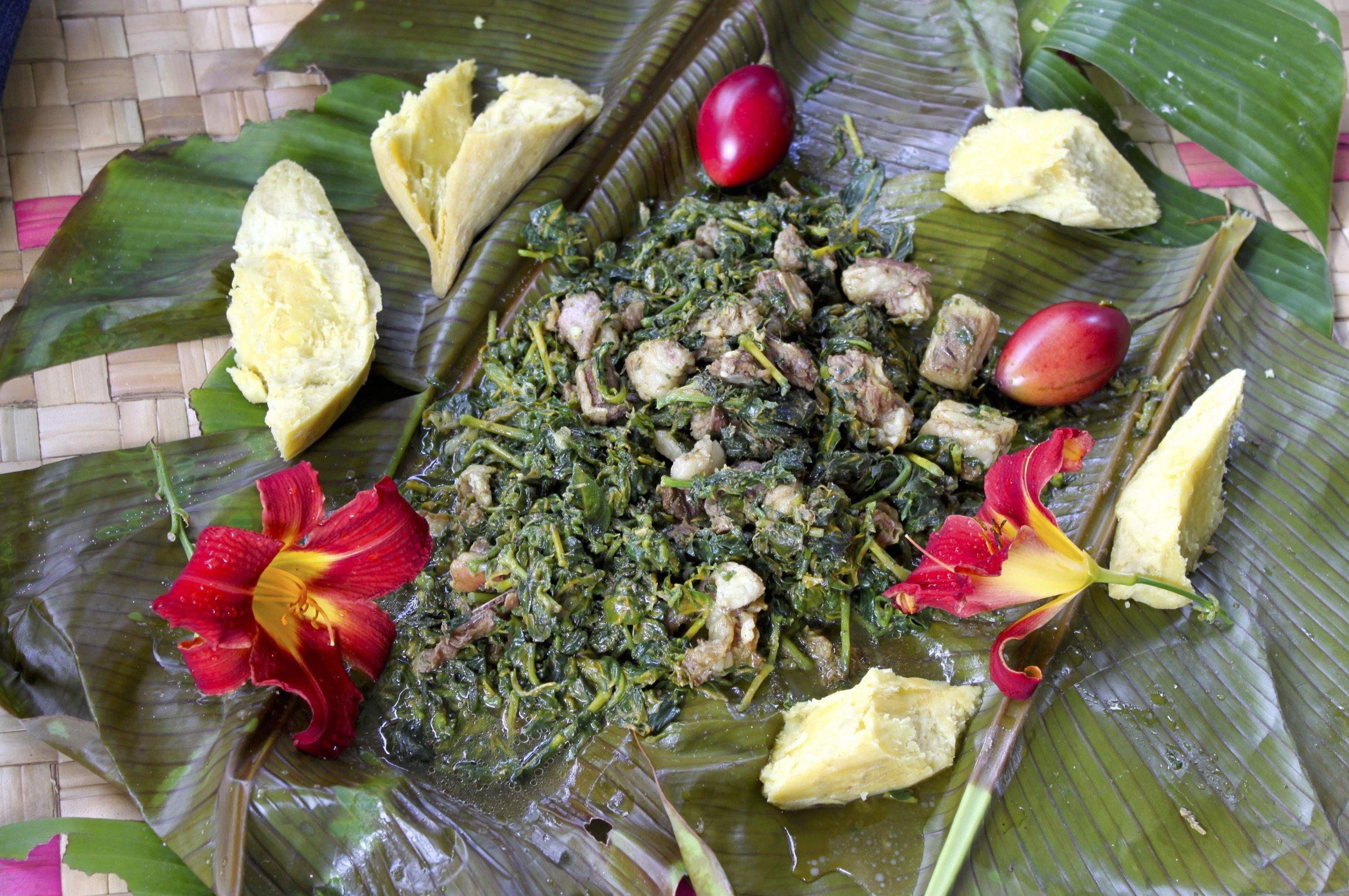 Bamboo cooking dish with lamb and kembempa fern greens from Tanna island, Vanuatu