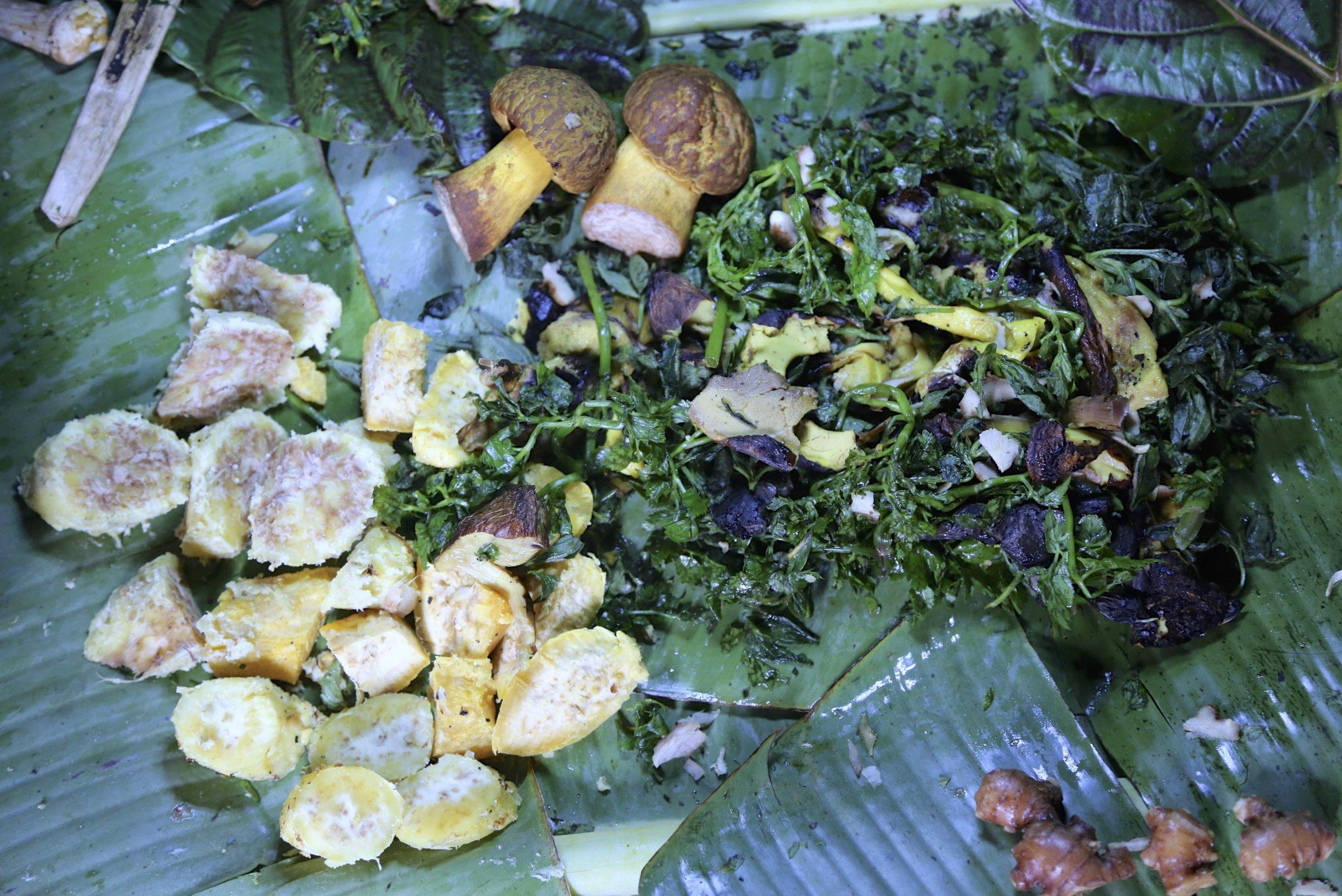 Wild mushrooms and sweet potatoes with bush ferns prepared in Solomon Islands