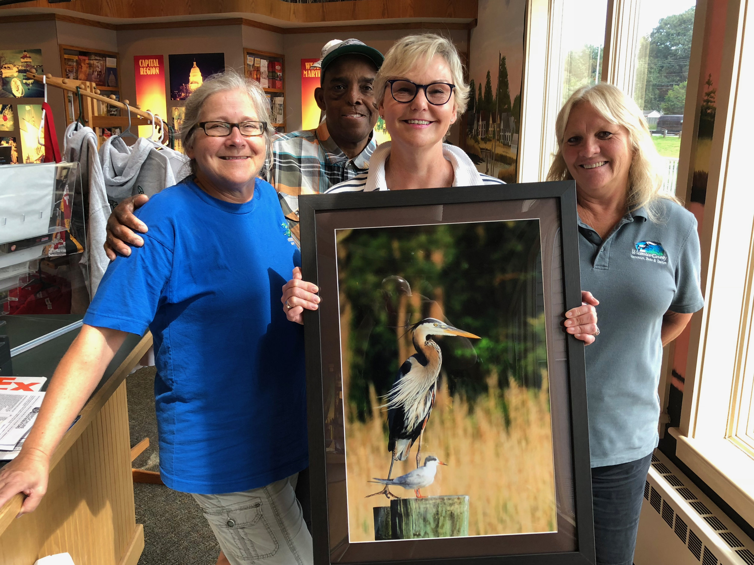 "The winner of the Wicomico County Photo Contest. My photograph ""TWO FRIENDS"" will be displayed at the Wicomico County Tourism Center in Salisbury, MD. Photo includes the staff members Stacy Cooper, Earl Donaldson and Debbie Littleton"