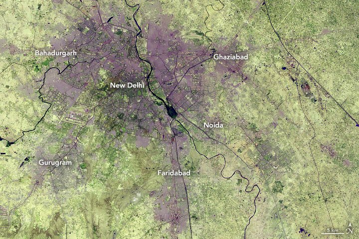 Croplands and grasslands around New Delhi are being converted into city structures to create one of the fastest urban expansions in the world. Credit: NASA Earth Observatory