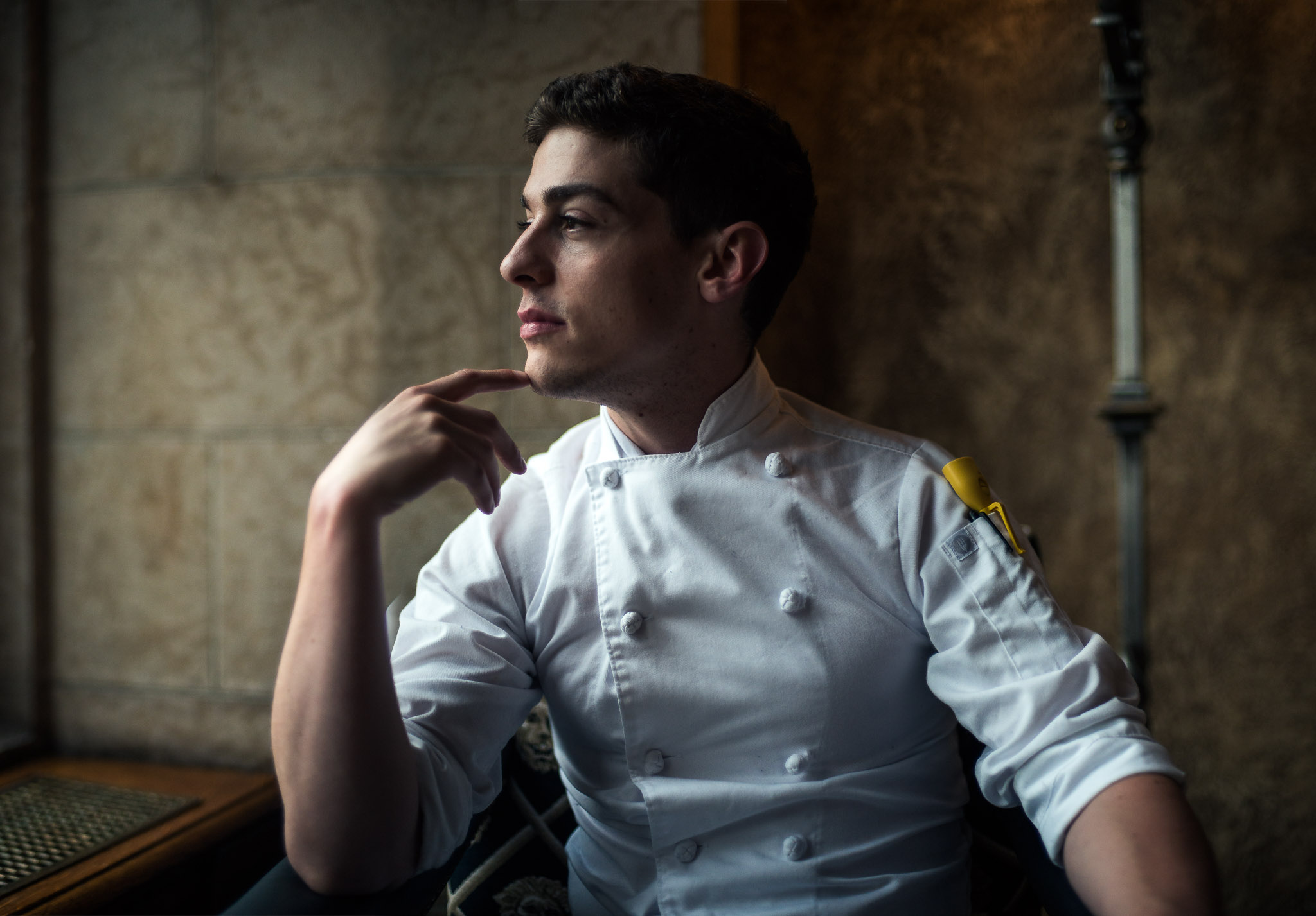 Maxim chef looking outside window