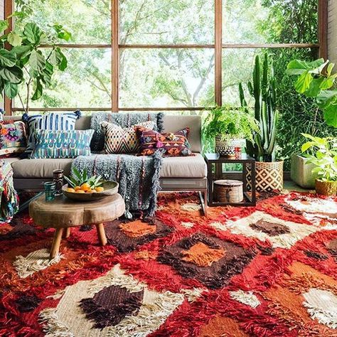 A textured, colourful rug adds depth to a room... don't be afraid to clash.   Image: Pinterest
