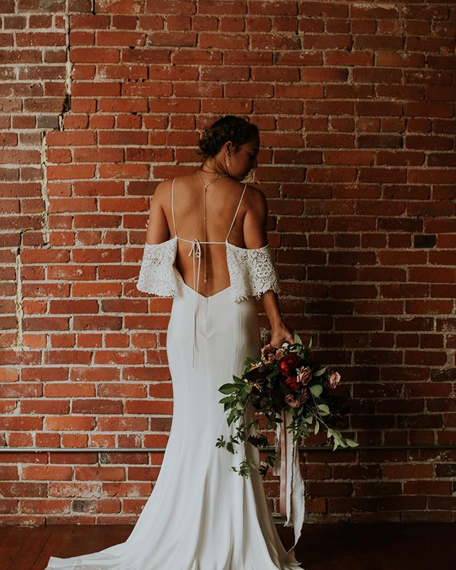 Keeping it casual in this low back stunner of a gown! Grateful for our job and all the creative freedom we get to explore!  Photo by @dlubbersphotography  Dress @somethingbluevancouver  Florals @juniper_flowers  Jewellery @kw_jewellery  Model @tarynelle