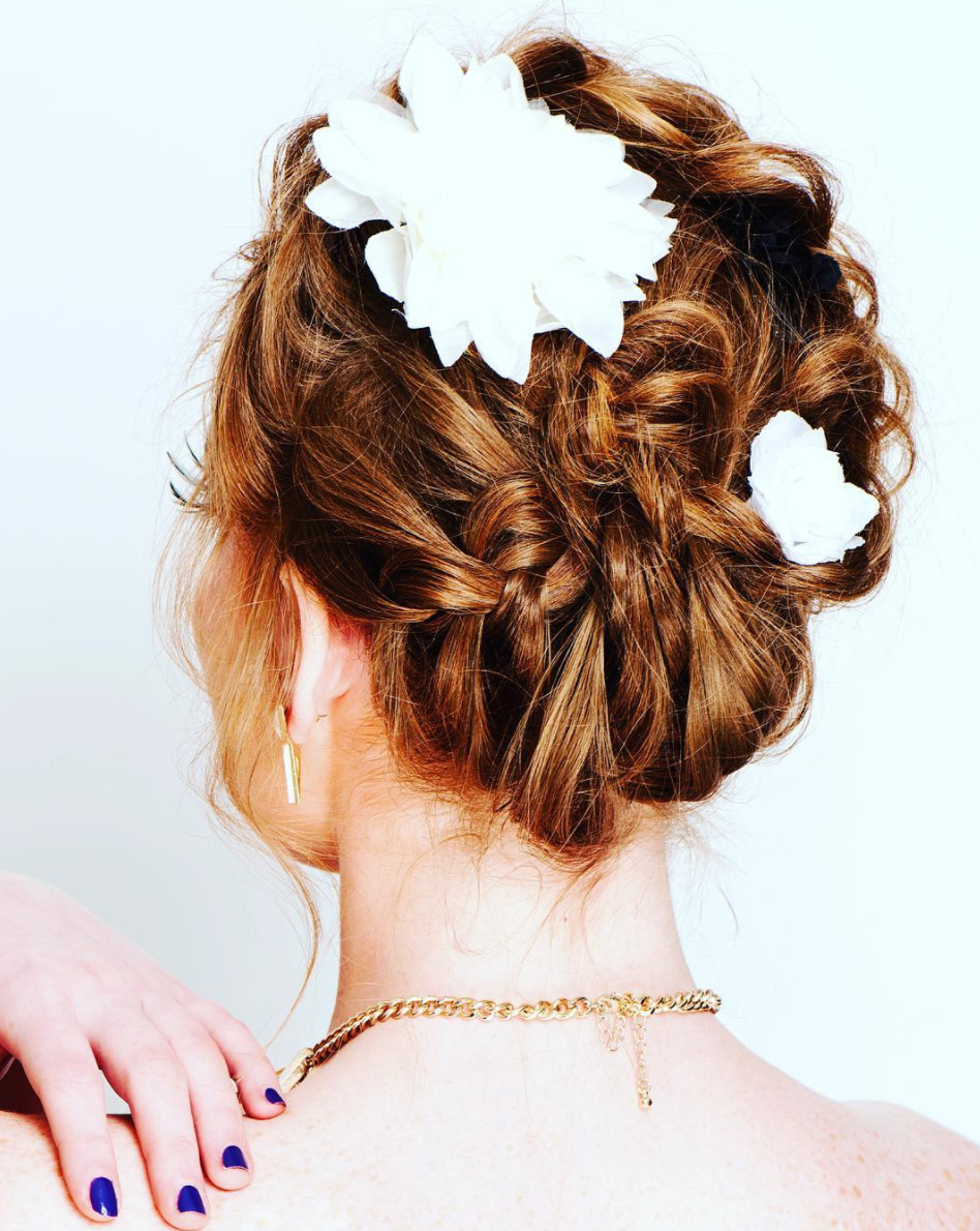 Romantic braids entwined into an effortless updo 💚  #hairstylist #hairartist #hairdresser #braids #updo #upstyle #hairup #boho #bohohair #weddinghair #bridalhair #guidesforbrides #organichaircare #greenbeauty #naturalbeauty #wedding #weddings