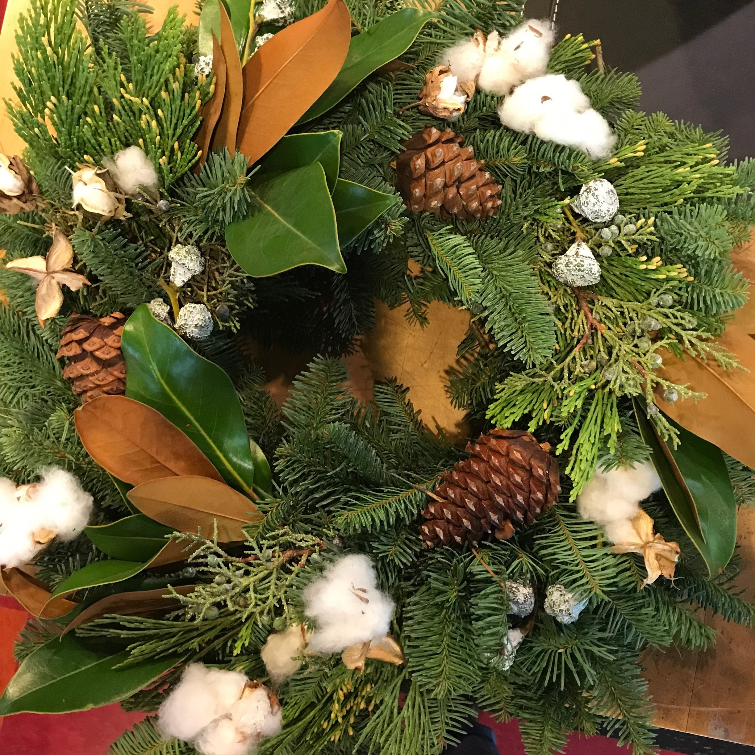 The snowy cotton really pops on this wreath, also made in-house at Welch.