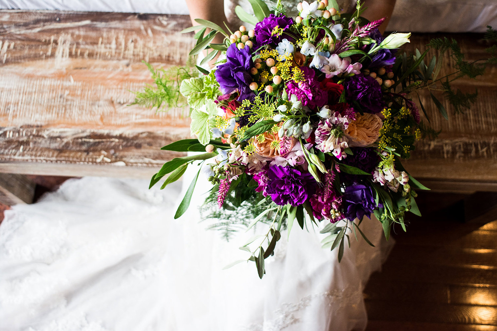 bride sitting on bench with flower bouquet 2000px.jpg