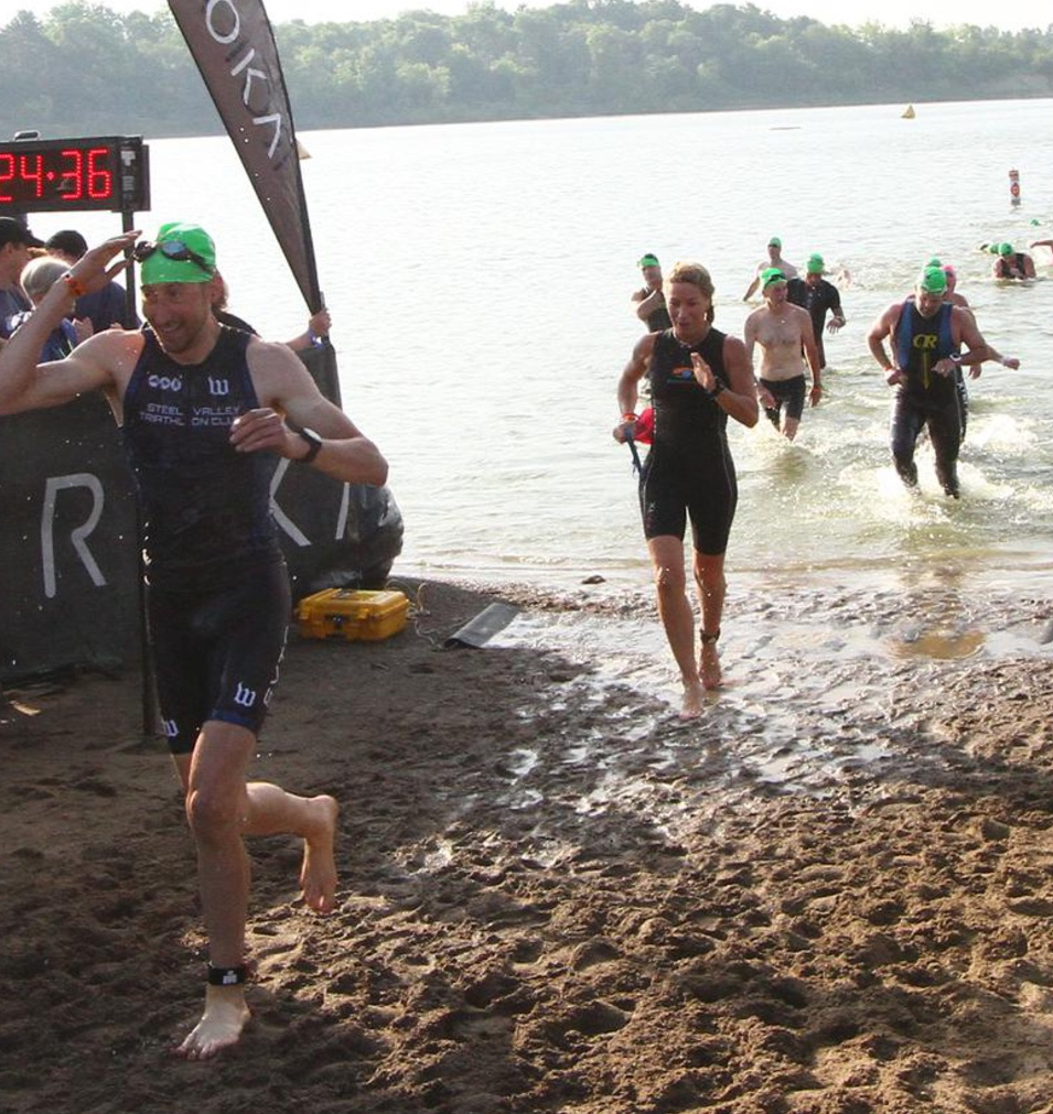 Ironman 70.3 - Ohio. Coach Amy energized and relieved coming out of the LONG swim.
