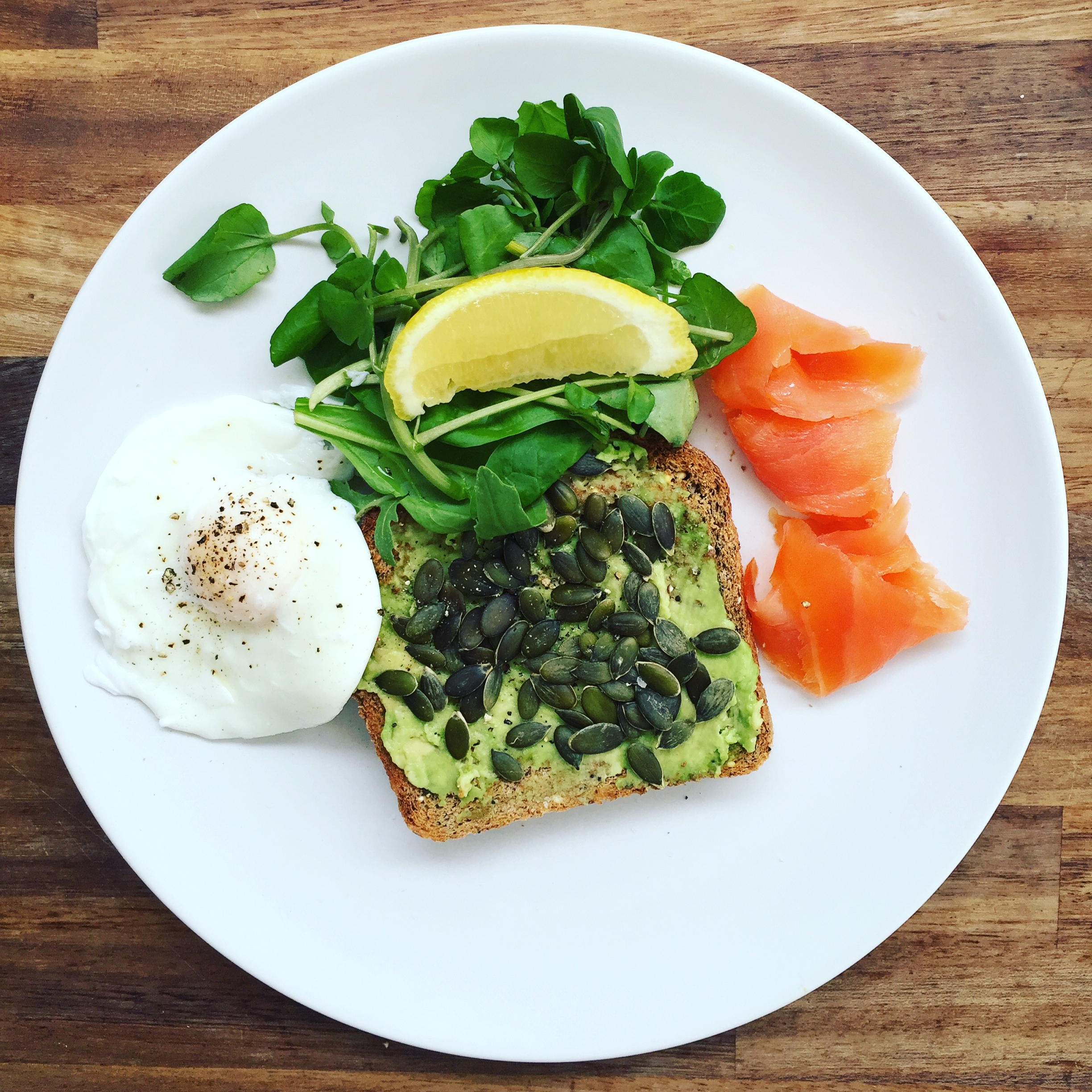 There's no reason not to add some greens to breakfast, and knocking Kale off the top spot for superfood of the moment is watercress. Yep it's peppery and intense, but what better way to wake yourself up in the morning...Here I've got some homemade bread my dad baked (Waitrose packet), with mashed avocado and pumpkin seeds, accompanied by protein rich poached egg and for a bit of a treat, smoked salmon. No reason to snack when you've had this healthy load.  For GF : Exchange the bread for Gluten free  For Vegans : Increase the greens,add a dollop of houmous and a side of beetroot