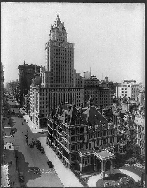 [Bird's eye view looking south from Fifth Avenue at 58th Street at the 26-story Heckscher Building (c. October 1921), southwest corner of Fifth Avenue at 57th Street, with Vanderbilt Mansion (since replaced by Bergdorf Goodman) in foreground]. 1921. Image. Retrieved from the Library of Congress, <https://www.loc.gov/item/2004673286/>.