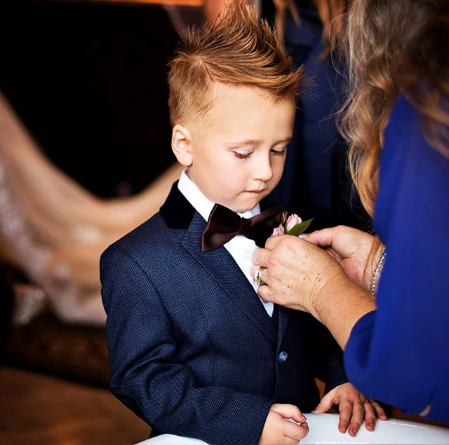 TBT to this cute little guy getting ready for the most important job of any wedding!  The ring bearer! . #ringbearer #copswedding #azwedding #wedding #littlesuit #bowtie #bluetuxedo #mowhawk