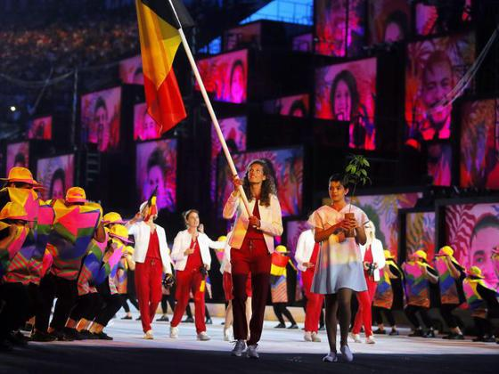 Sprinter Olivia Borlée carries the Belgian flag at the opening ceremony of the 2016 Rio Olympics.