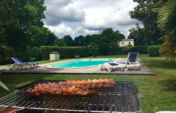 """Meanwhile back at the rented villa, barbecue and a refreshing swim awaited the """"Boys in Red""""."""