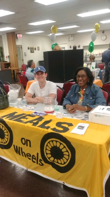 Pictured, tending the MOWNR table, are Deacon Hyacinthe Lee and Nicholas Pallotta, home from college for the summer. Also helping was his mom, MOW volunteer Maureen Pallotta.