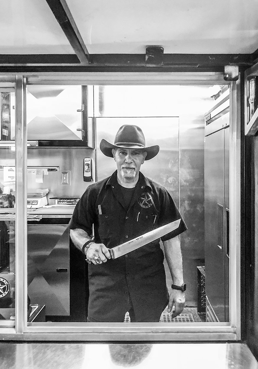 Pitmaster Ara Malekian with his custom knife. Photography by Daniel Vaughn