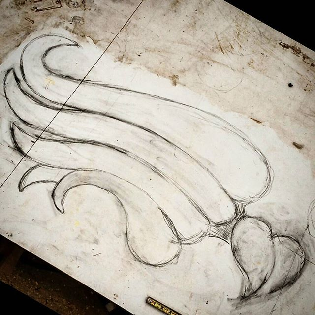 Laying out a new headboard. #carvedhearts #carvedwood #carvedwings #customfurniture #architecturalfurniture #design #designer #interiordesign #interiors