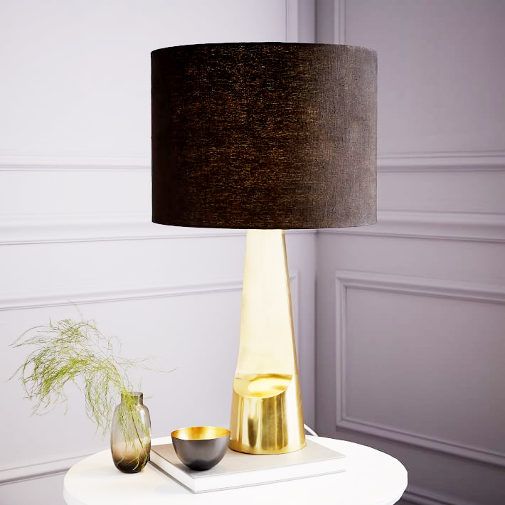 Sculptural Metal Table Lamp . It's no secret I love a brass lamp with a black drum shade. The unique shape of this lamp base will add personality and a sense of vintage flair to any dark corner. $179.