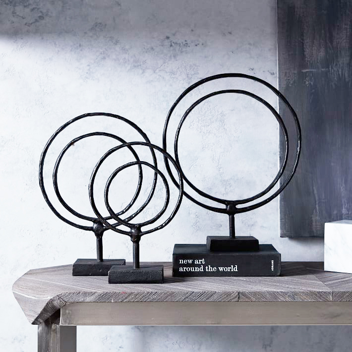 Ring Sculptures . I love the inconsistencies and handmade-like quality of these metal accessories. Use them in a grouping for major impact or select a single size to incorporate into your bookshelves to add visual height and interest. $39 and up.