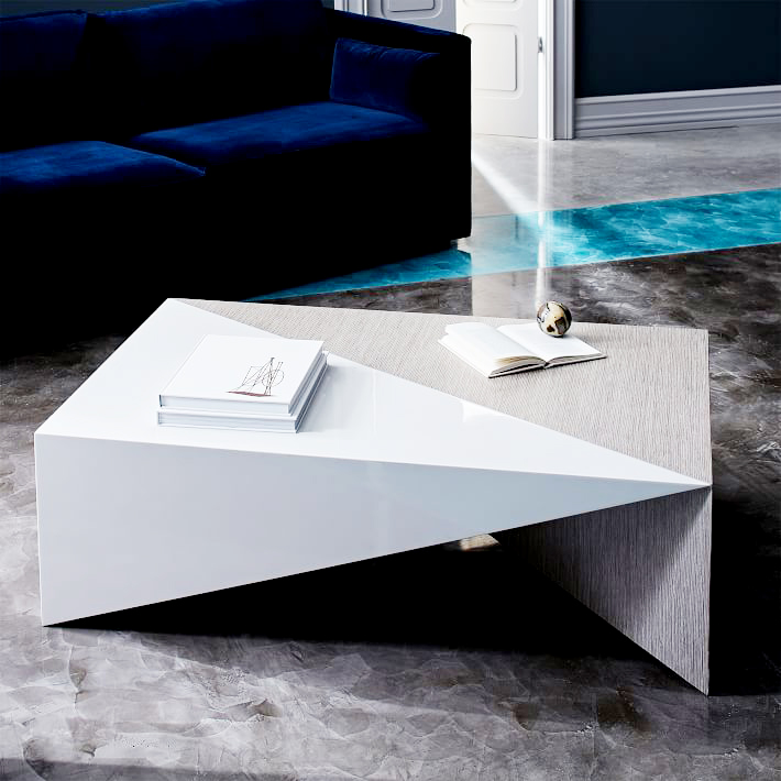 Faceted Lacquer Coffee Table . Ok, how amazing is this piece? A combination of sleek white lacquer and heavily-grained wood, this is the ultimate textural and sculptural centerpiece for a living room. $599.