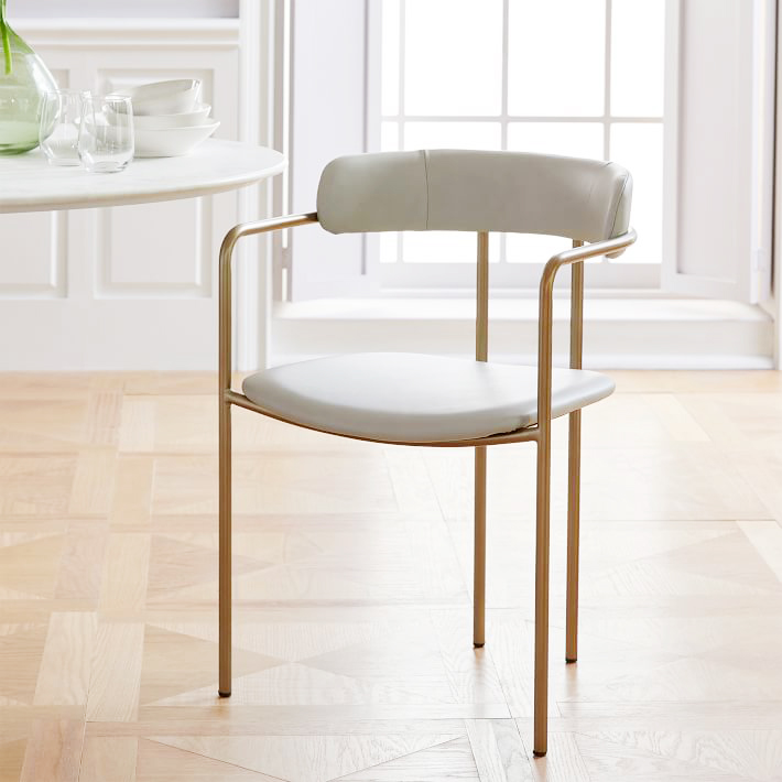 Lenox Leather Dining Chair . Delicate and feminine, I would pair these sleek dining chairs with a heftier wood table to add contrast and interest to even the smallest of dining spaces. $349.