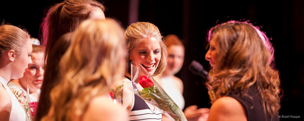 faculty-receiving-roses-after-performance.jpg