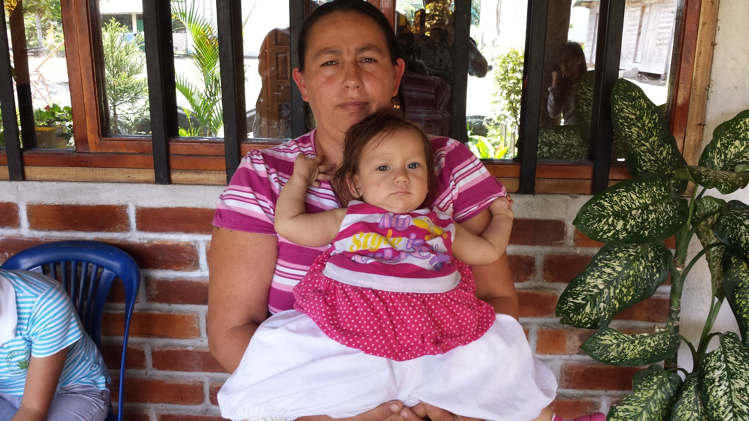 Scarlet with her Mom, Ines. She had a complete body cast around her hips that prevented hip movement.