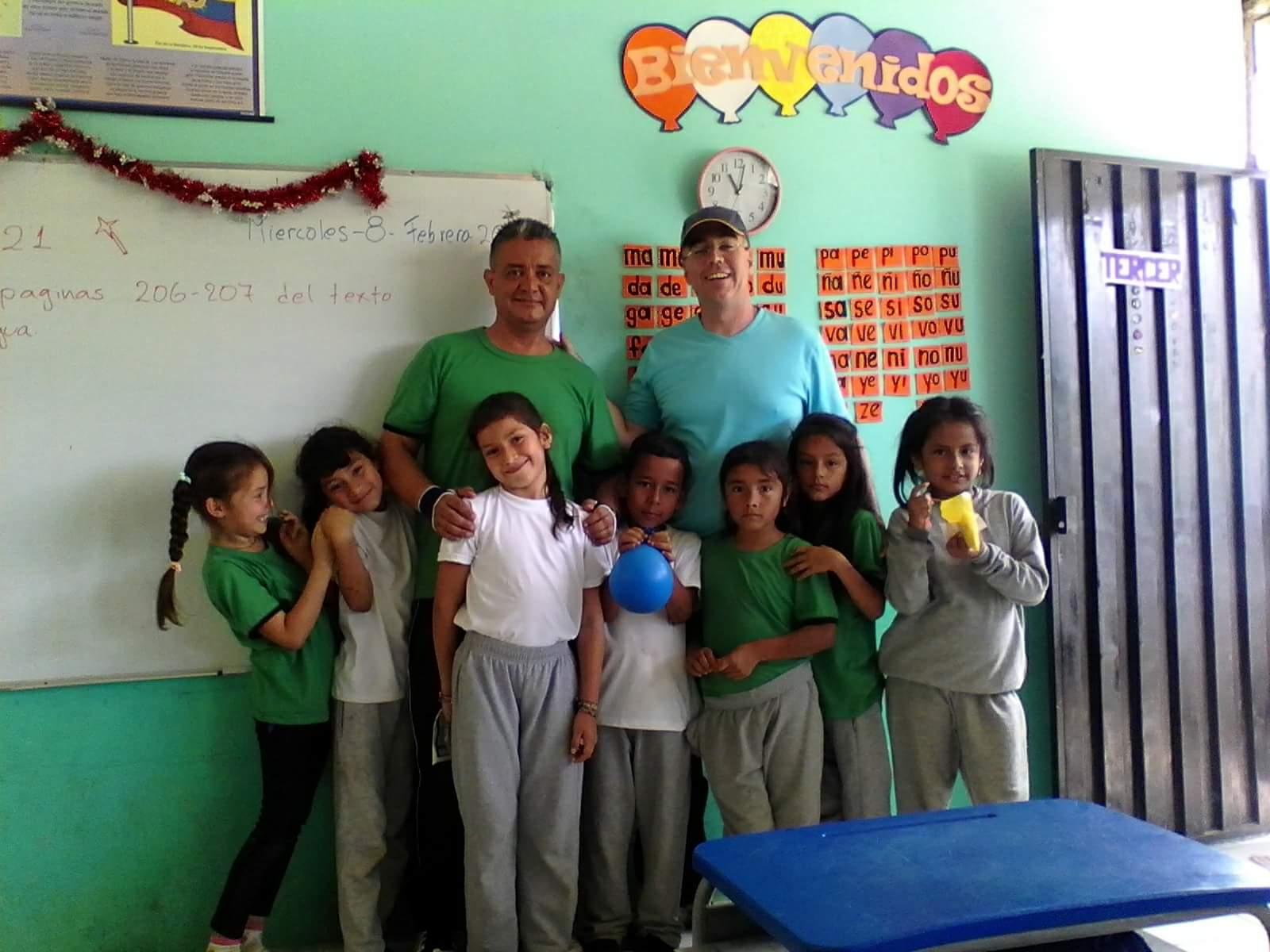 Some 2nd-graders and their teacher Samir.