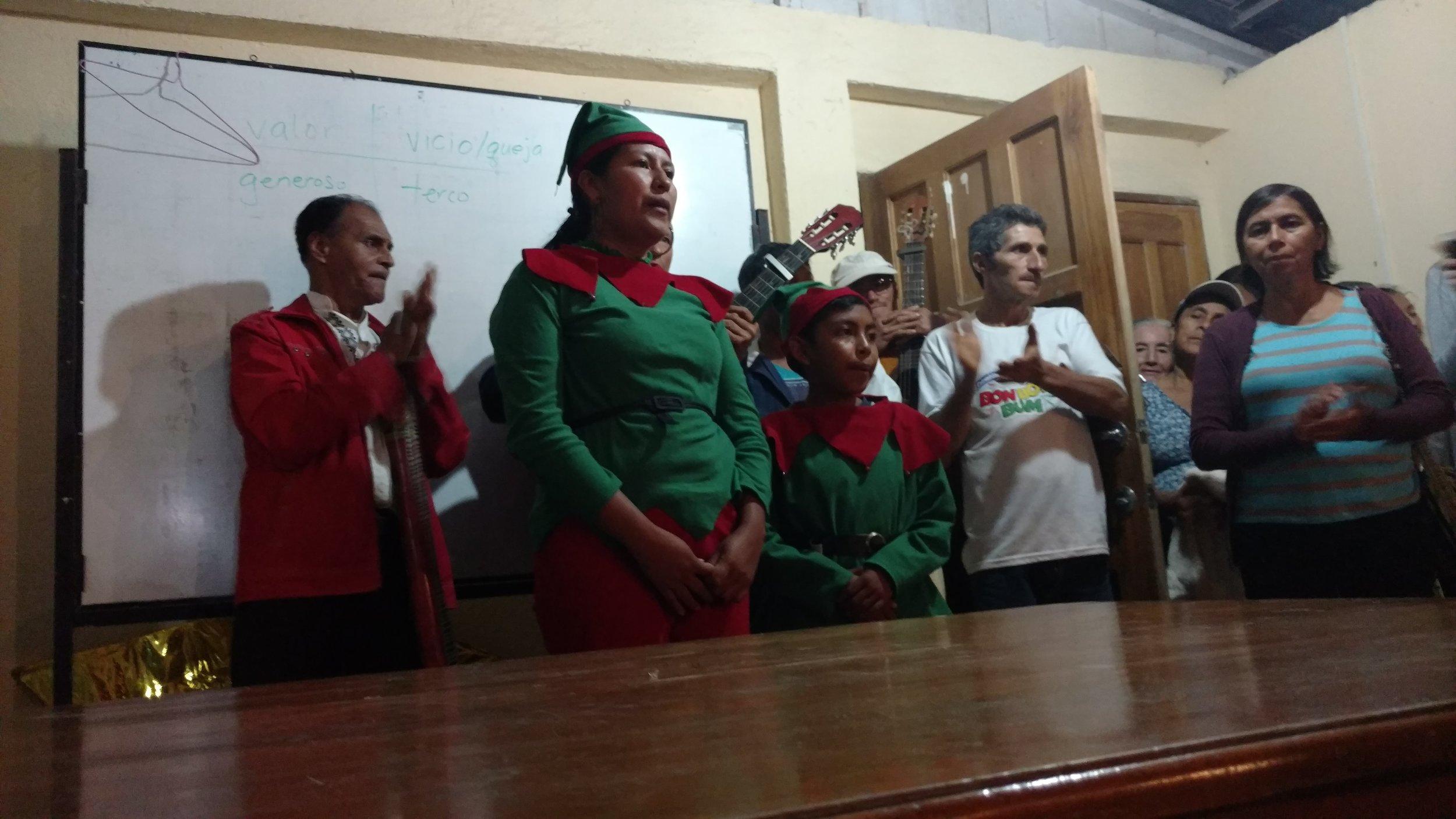 Families singing Christmas Carols in Christmas Eve