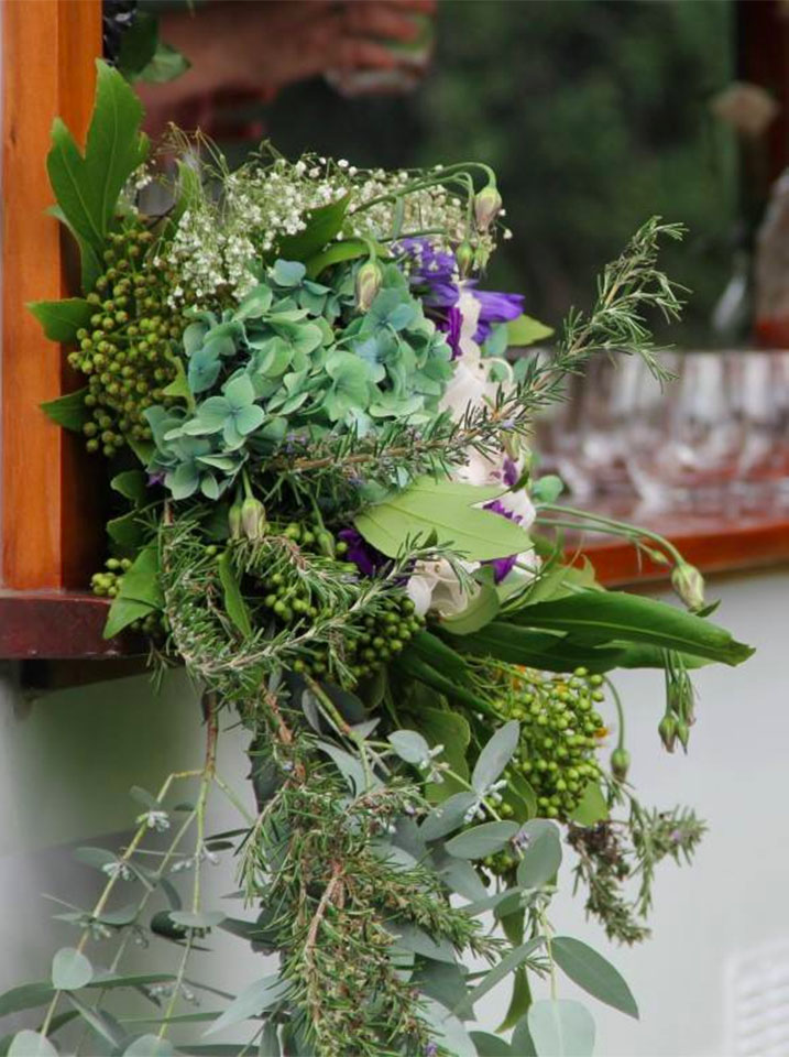 Flower arrangement on the bar by Wildflowers Coromandel