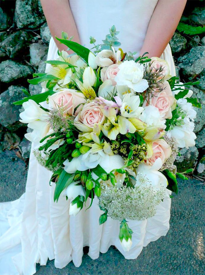 Bouquet featuring peach roses and greenery by Wildflowers Coromandel