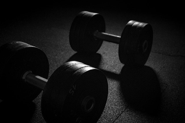 Lifting weights can cause localised muscle damage which we feel as soreness in the proceeding days.
