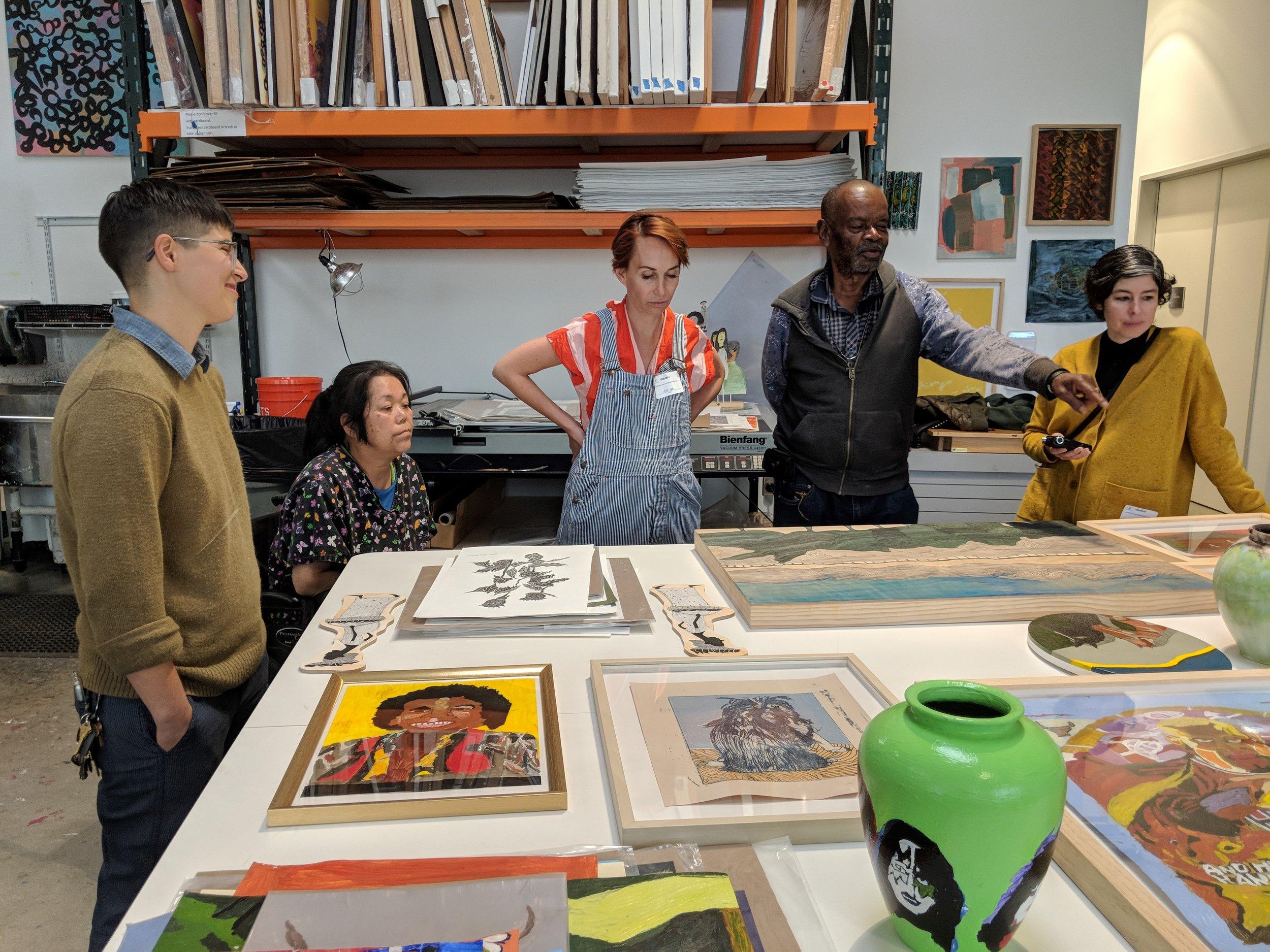 Image (left to right): ECF's Program Supervisor Eugenia Barbuc, artist Vickie Uyeda, The Main's director Allison Agsten, artist Milton Davis, and The Main's curatorial associate Monica Rodriguez looking at Milton's and Vickie's work at ECF