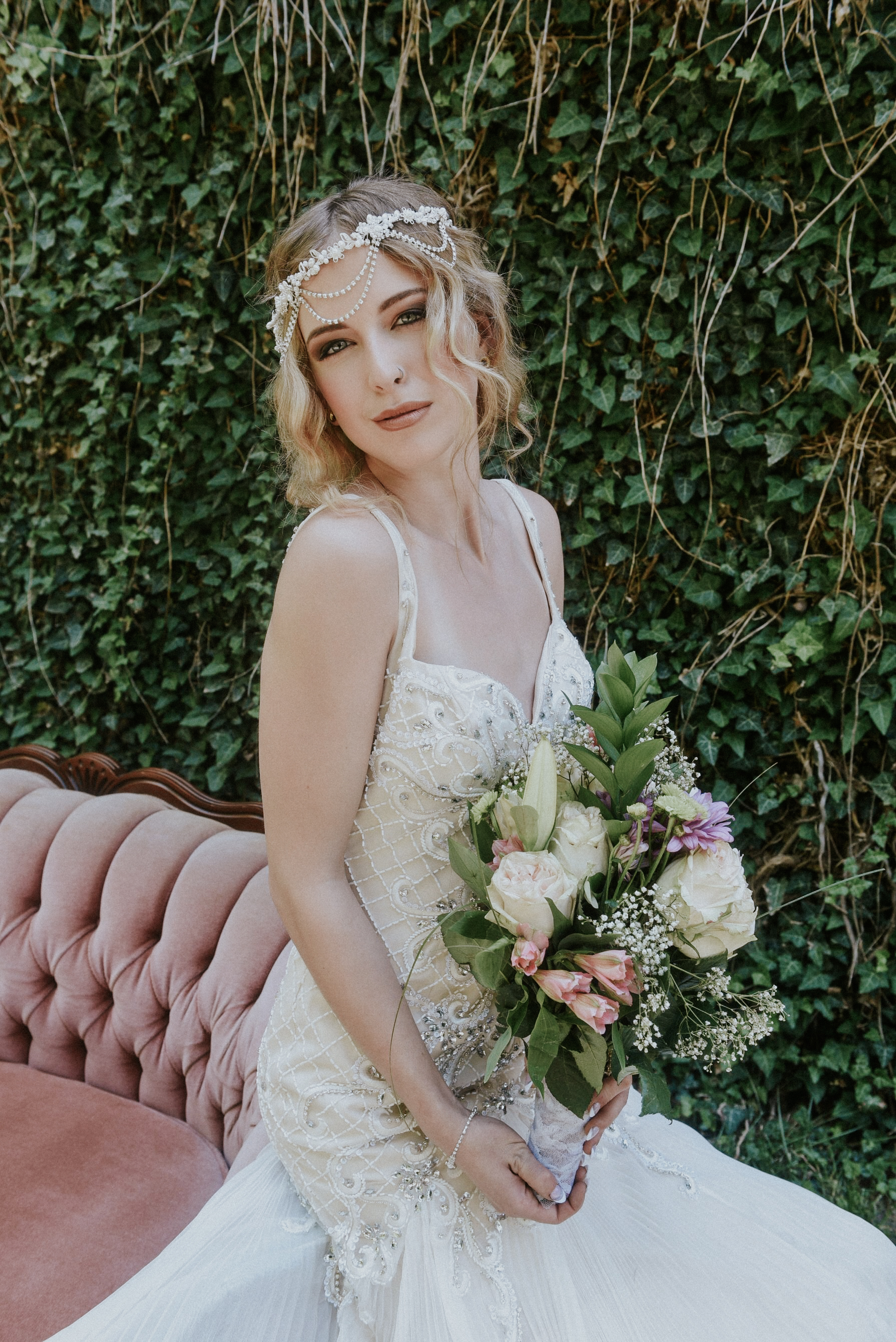 Pearl and stone beaded bridal dress siren shape with train, and headpiece by La Creme St. Jacobs. Relaxed boho bridal braid by Rachel Jones BPretty Make-up & Hair Stylist. Wedding photographer Julie Sawatzky Julie Nicole Photography Ontario Canada