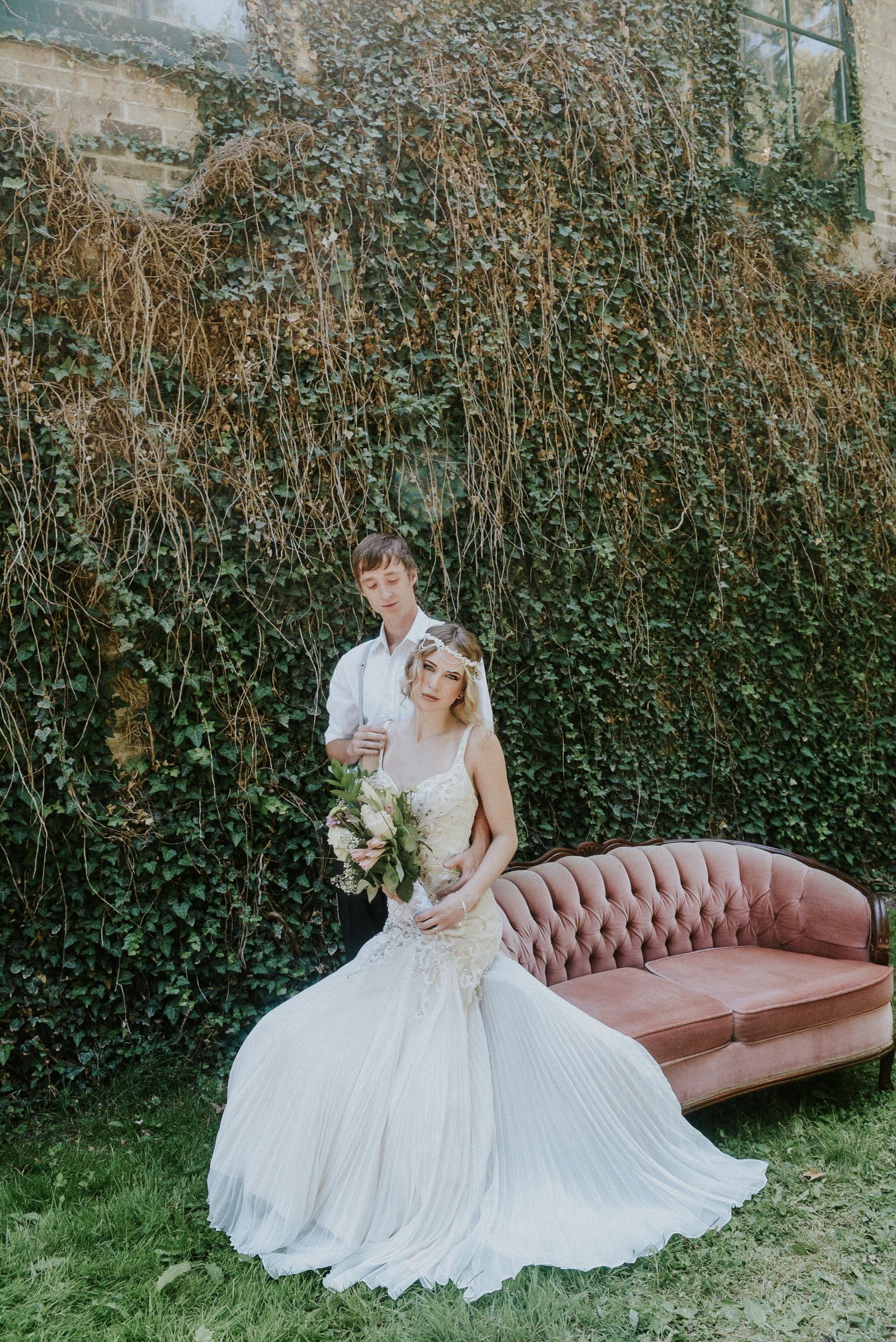 Pearl beaded wedding dress pink velvet sofa styled shoot