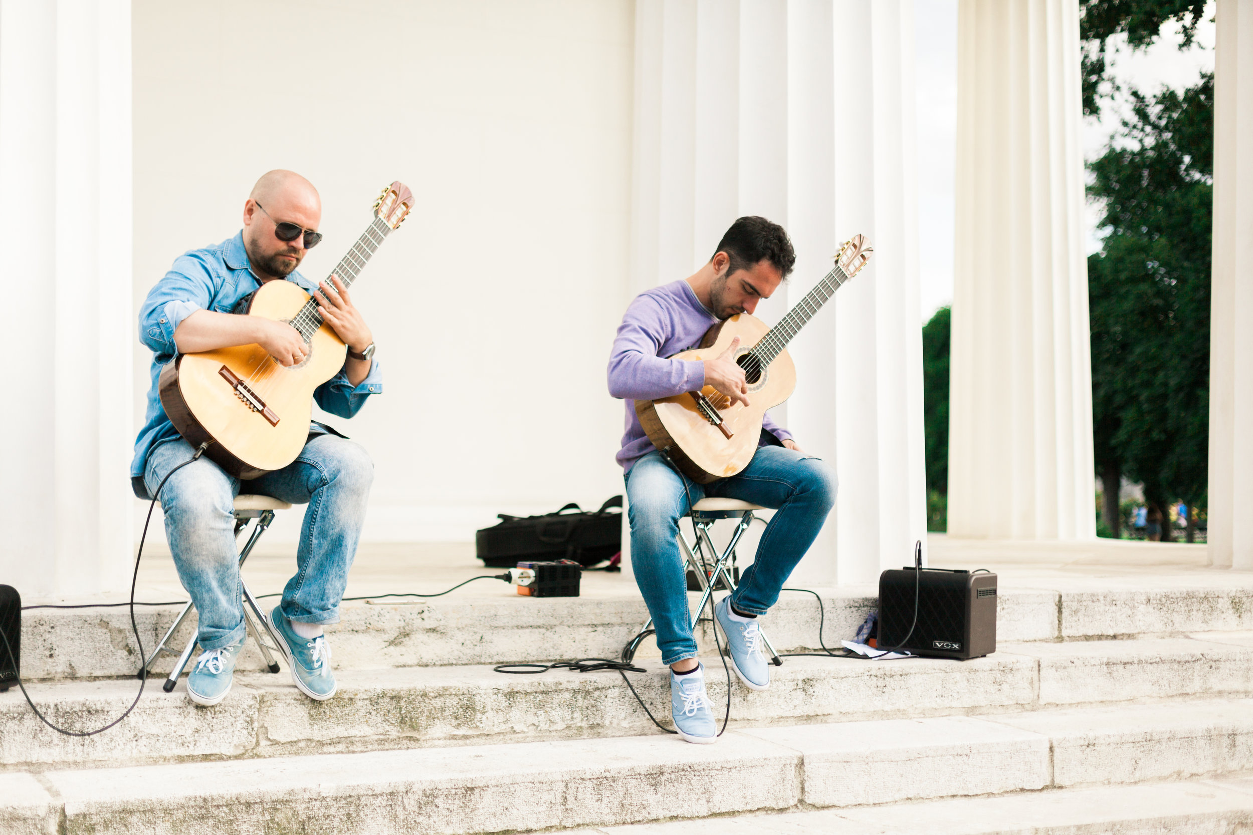 Playing guitar in Volksgarten Hofburg Vienna Austria by Film photographer Michelle Mock