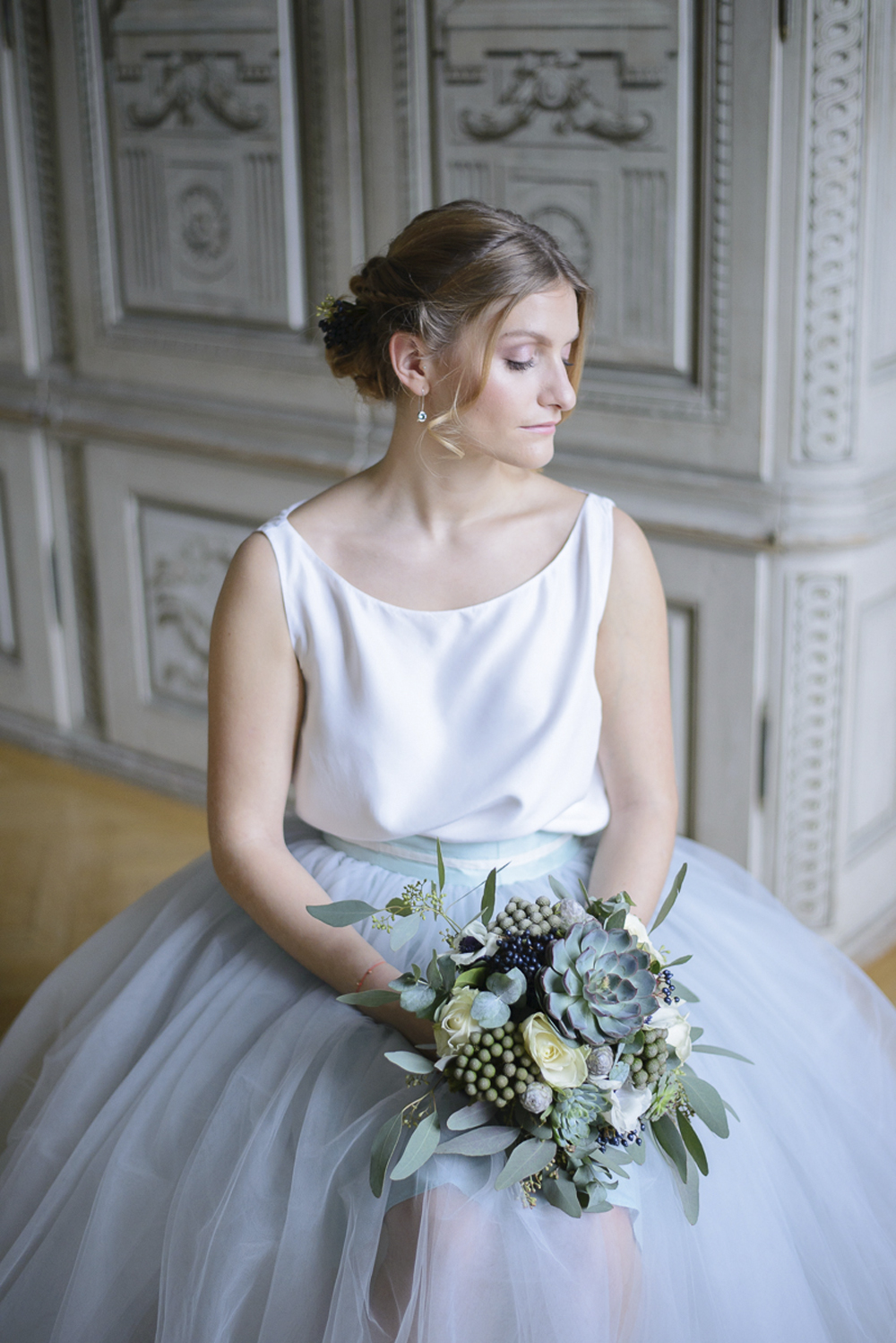Bride with baby blue tulle skirt and succulent bridal bouquet at Schloss Laudon Vienna Austria by Barbara Wenz Photography