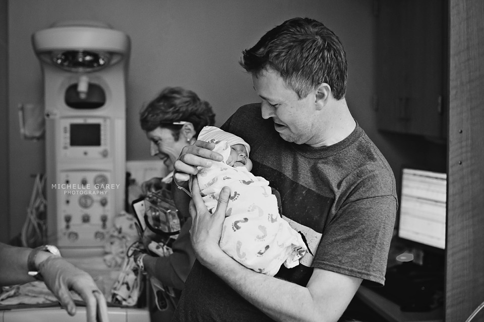 Dad Holding Daughter : Denver Birth Photographer